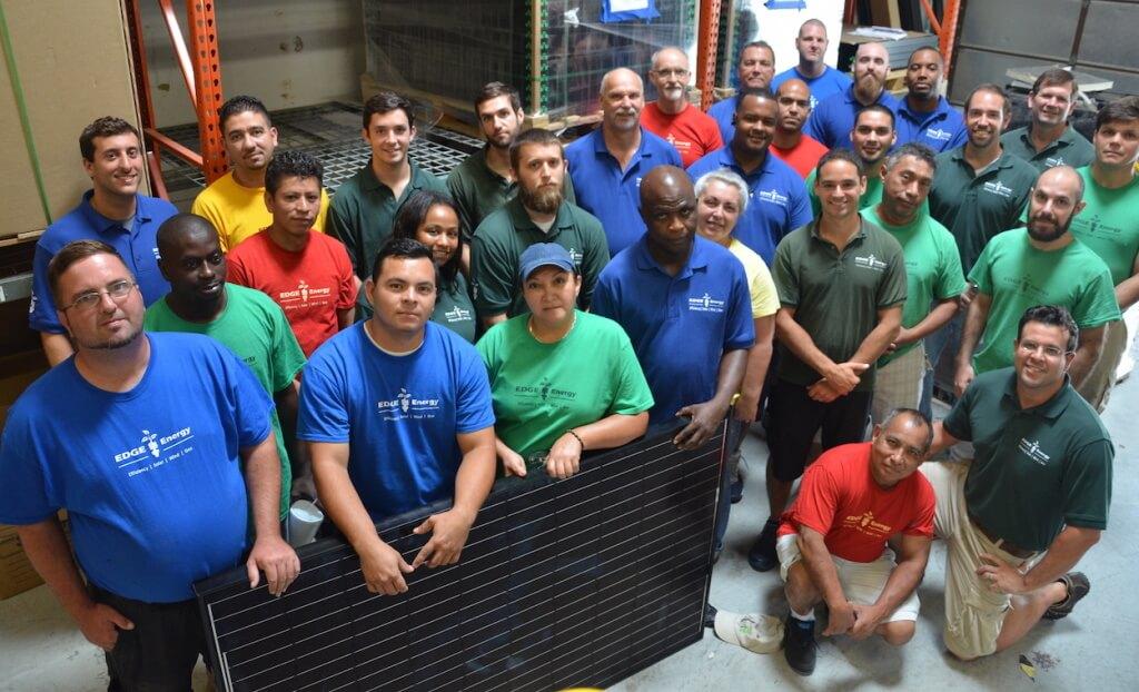 Staff Inside Holding Solar Panel