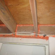 Foam board being used to insulate the band joist in a basement